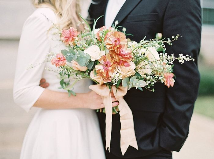 Picture-perfect peach, green and cream wedding bouquet or a simple and stylish elopement.