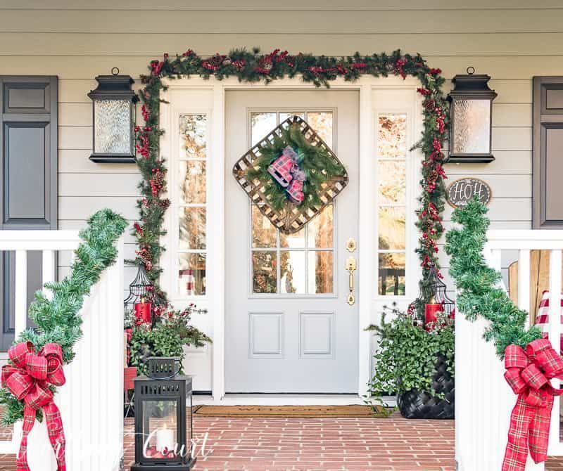 Quirky Home Decor Festive Christmas Front Porch Decorated With Red And Green Ch Ch In 2020 Front Porch Christmas Decor Christmas Front Porch Front Porch Decorating