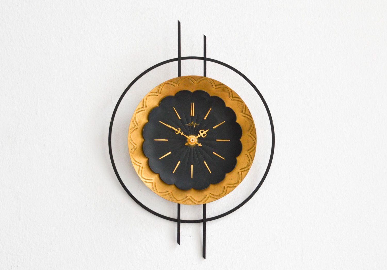 Vintage East German wall clock ebg GDR brass starburst sunburst Mid Century by MightyVintage on Etsy https://www.etsy.com/listing/263363636/vintage-east-german-wall-clock-ebg-gdr