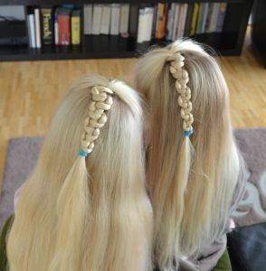Pull-up braids: one done by mum, the other one by dad. Can you guess which is which?