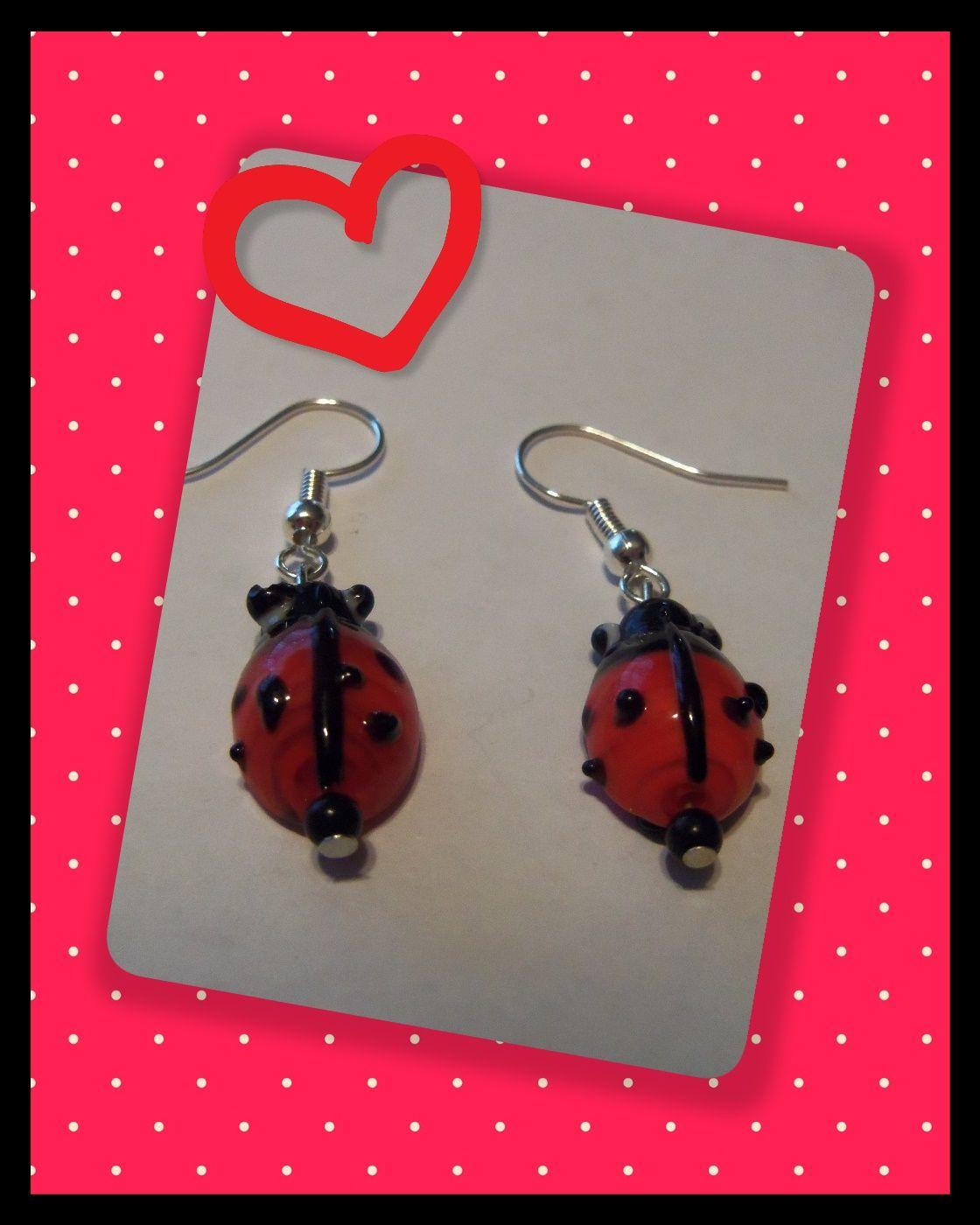 Earrings made using ladybug glass beads and small black