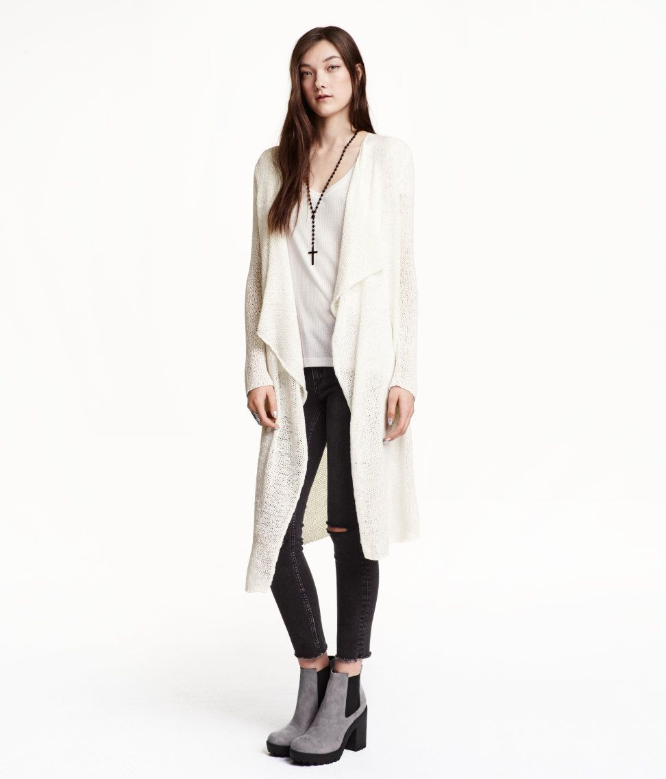 Throw this long white textured cardigan over a sun dress or bring it
