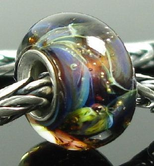 I've been following these beautiful, locally made lampwork beads on eBay for a while now.