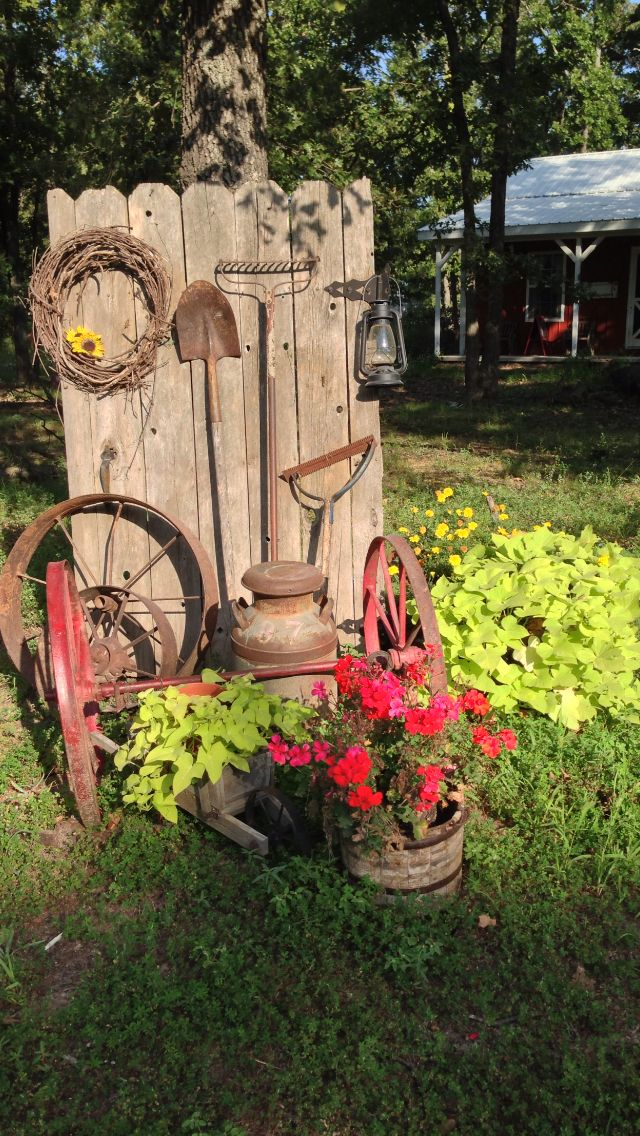 An old fence makes a nice back drop for rusty stuff and for Flower garden decorations