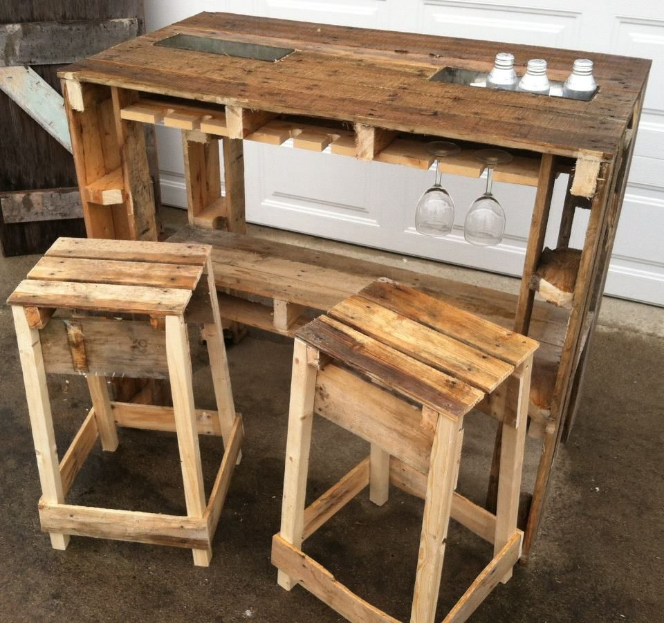 For the Man CAVE!! The Pallet Bar!! Complete with stainless beverage ice chests and wine glass holder. Also has a set of bar stools.