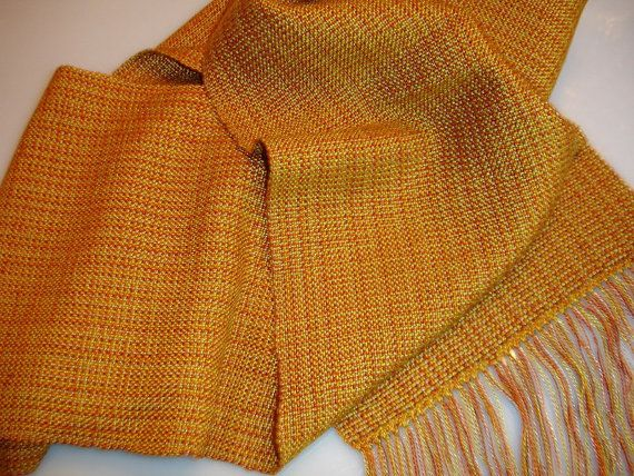 Check this out at https://www.etsy.com/shop/JoyfulNoiseWeaving This luxurious hand woven scarf is the perfect choice for that little black dress or that summer t-shirt and jeans. It's rich, beautiful color will add the perfect touch to any outfit and the lovely texture of the scarf will allow you to wear it all year long! This hand woven scarf is woven with tencel which gives it a beautiful feel and drape.  https://www.etsy.com/shop/JoyfulNoiseWeaving