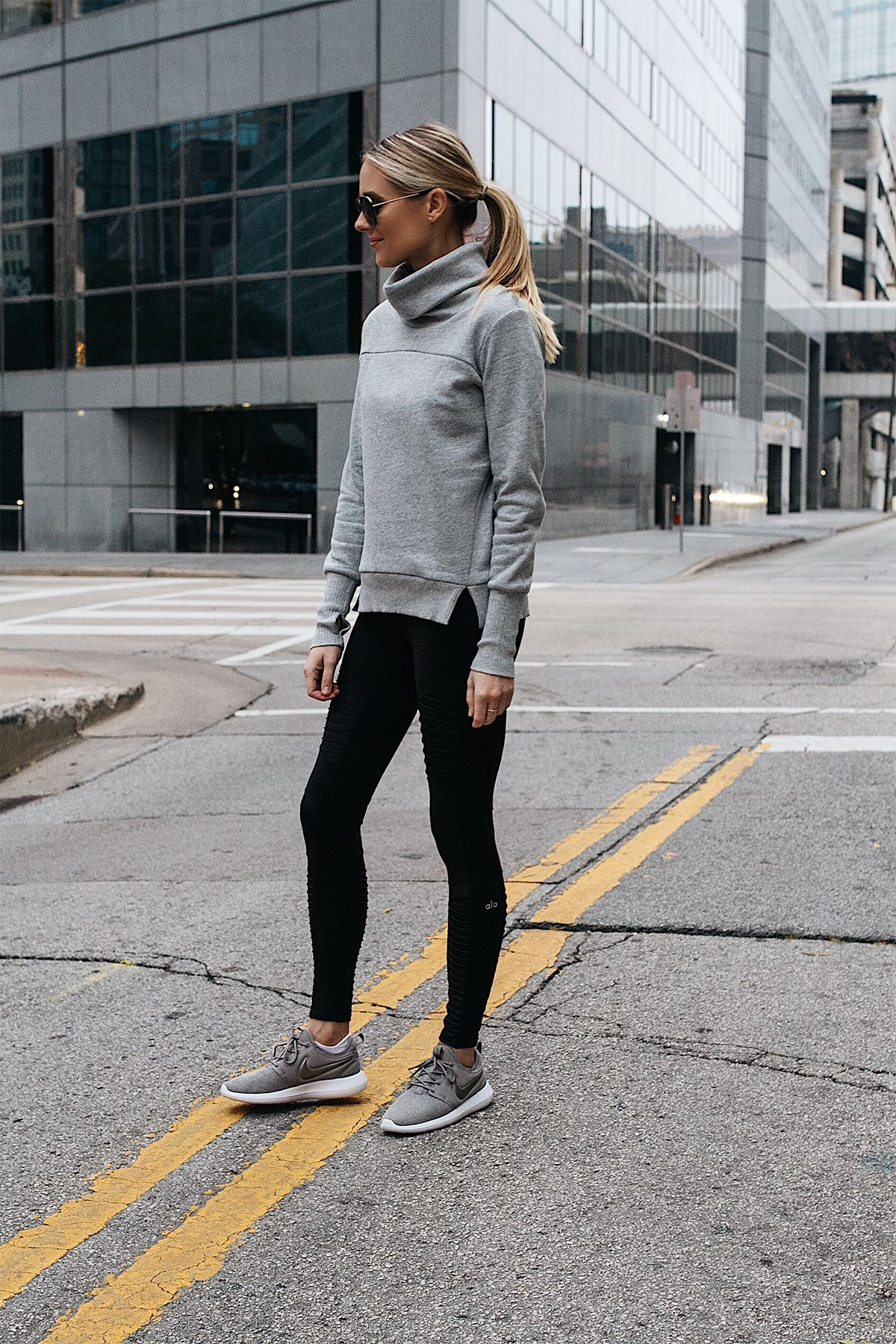 590ff07f6c1 Blonde Woman Wearing Alo Grey Funnel Neck Sweatshirt Alo Black Moto Leggings  Nike Roshe Two Knit Grey Sneakers Fashion Jackson Dallas Blogger Fashion ...