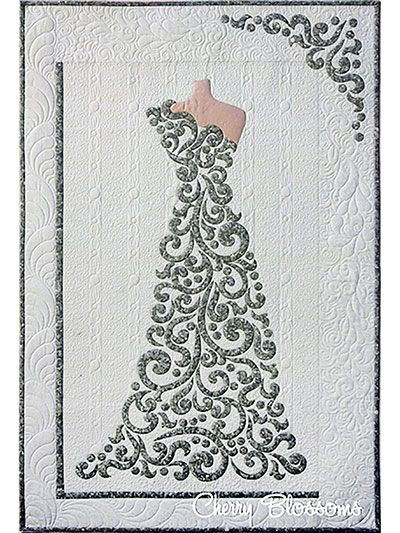 Give an elegant gift to a new bride or bride-to-be with this easy laser-cut kit.   This magnificently detailed wall hanging is ideal to give as a thoughtful wedding present. The kit includes laser-cut pieces for all the applique pieces, the step-by-step pattern, and instructions for completing the rest of the quilt. Each piece is pre-fused so all the hard work is already done for you. You just choose the perfect fabrics to match. Note that no background, border or backing fabric is included…