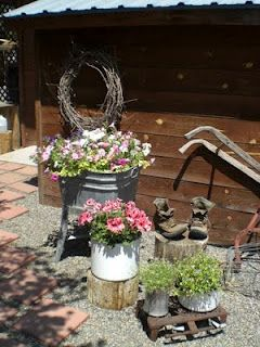 Planting Flowers In Funky Containers For A Rustic Look Container Flowers Rustic Flowers Unique Gardens