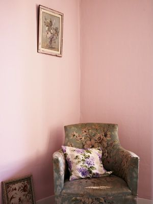 Fired Earth Hansel and Gretel pink wall paint with armchair
