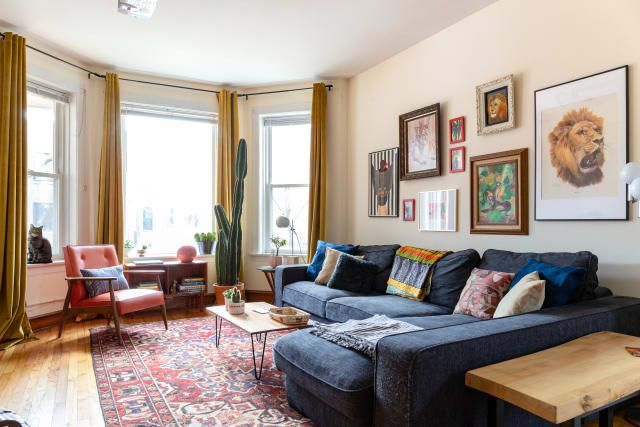 Cool Furniture And Cat Paintings In A Chicago Rental Home