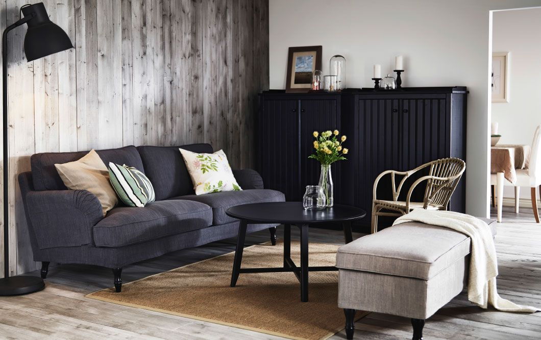 A living room with a grey STOCKSUND sofa, ARKELSTORP storage in ...