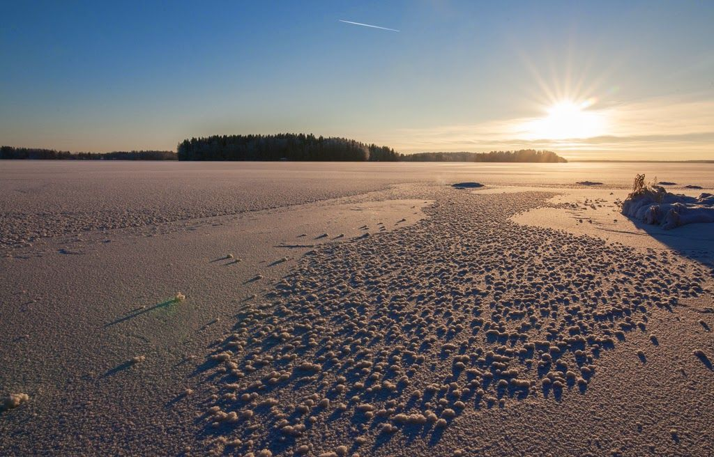 Winter season at lake Pyhäjärvi. You can see maiden of Finland drawn to the ice by nature.
