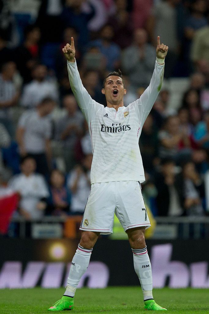 Cristiano Ronaldo of Real Madrid CF celebrates scoring their fifth goal during the La Liga match between Real Madrid CF and Elche CF at Estadio Santiago Bernabeu on September 23, 2014 in Madrid, Spain.