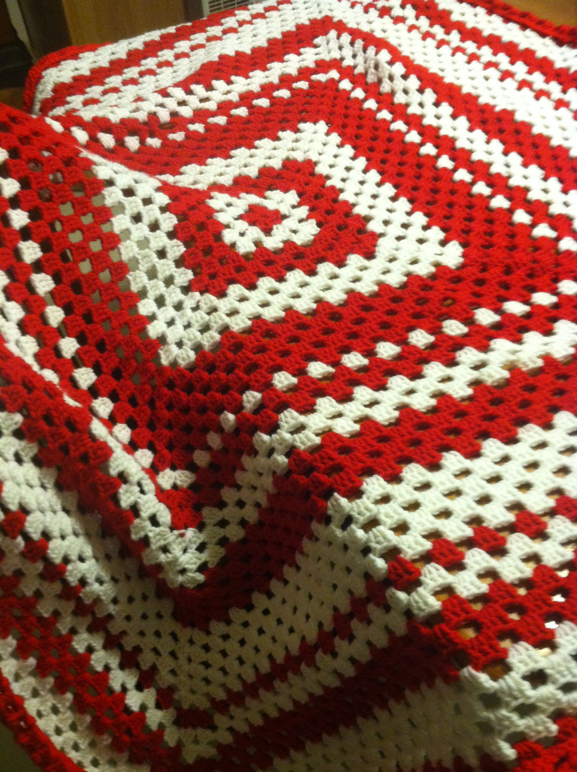 Red Wings colors giant granny square blanket.  I started with a basic granny square, then just kept adding rounds until it was about 6 feet long/across.