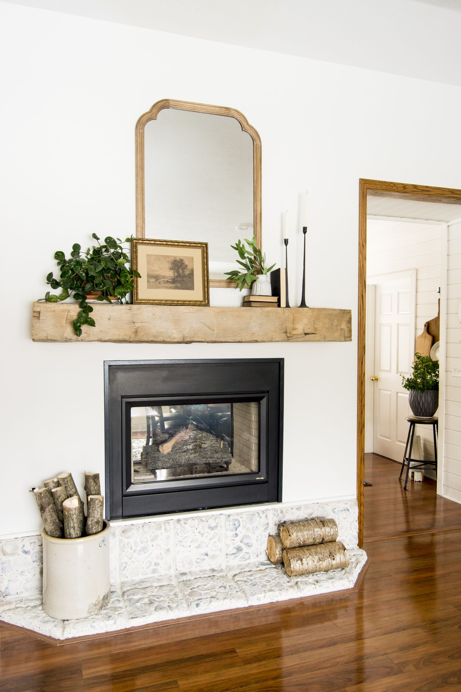 Do you want to add character to your home? Learn how we easily installed a floating barn beam mantel over our gas fireplace! #fromhousetohaven #mantel #floatingmantel #barnbeammantel #reclaimedbarnwood