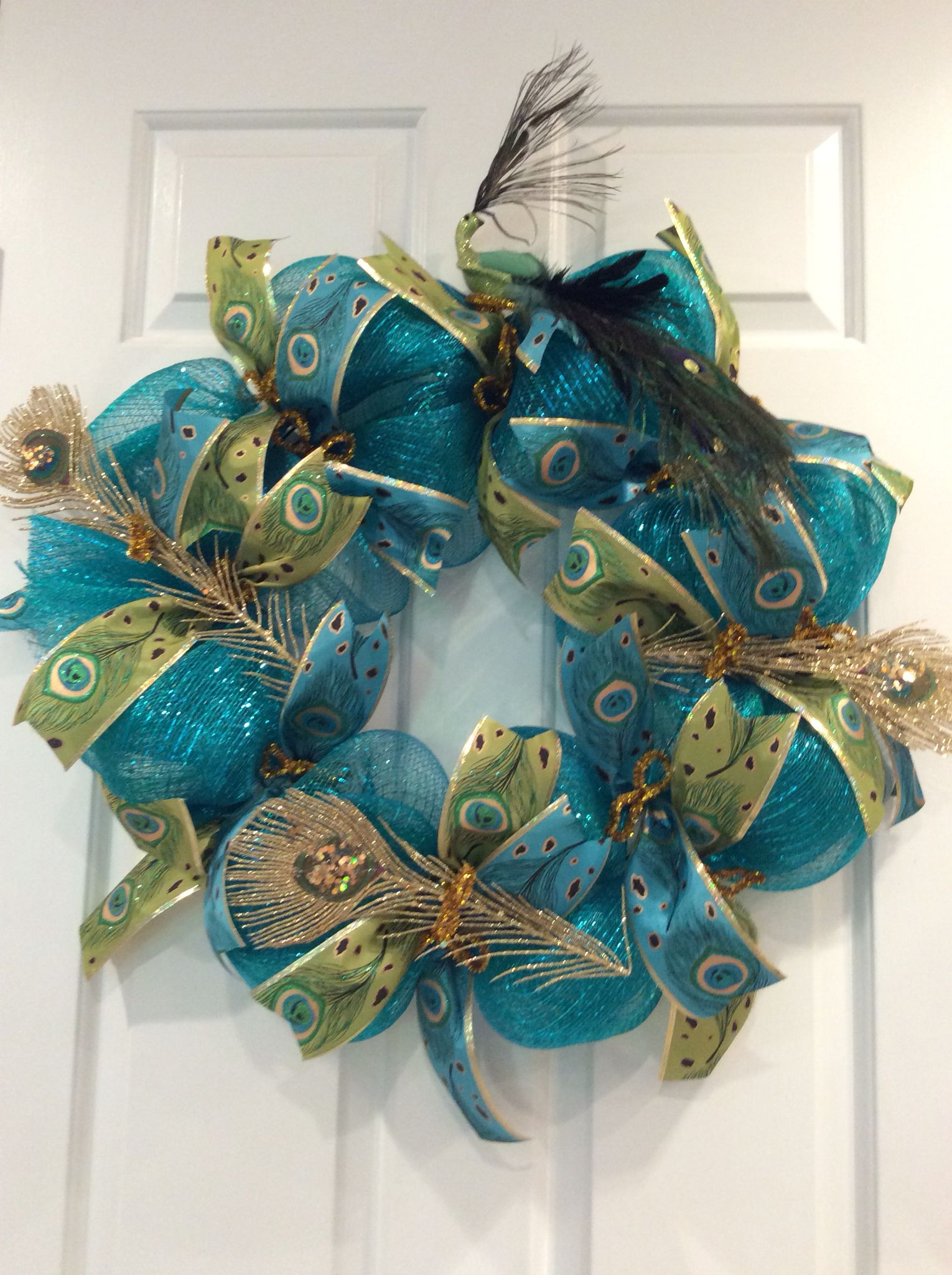 Peacock wreath made with turquoise mesh and peacock ribbon from ...