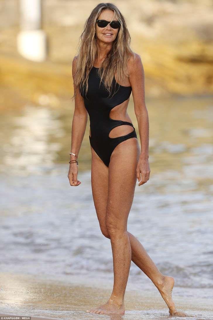 Elle Macpherson flaunts her toned figure in a sexy black swimsuit b36fe08e4f8