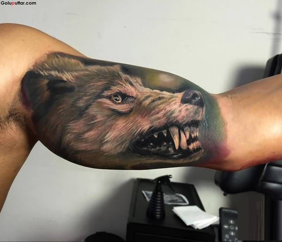 Man S Arm Decorated With Scary 3d Wolf Face And Teeth Tattoo