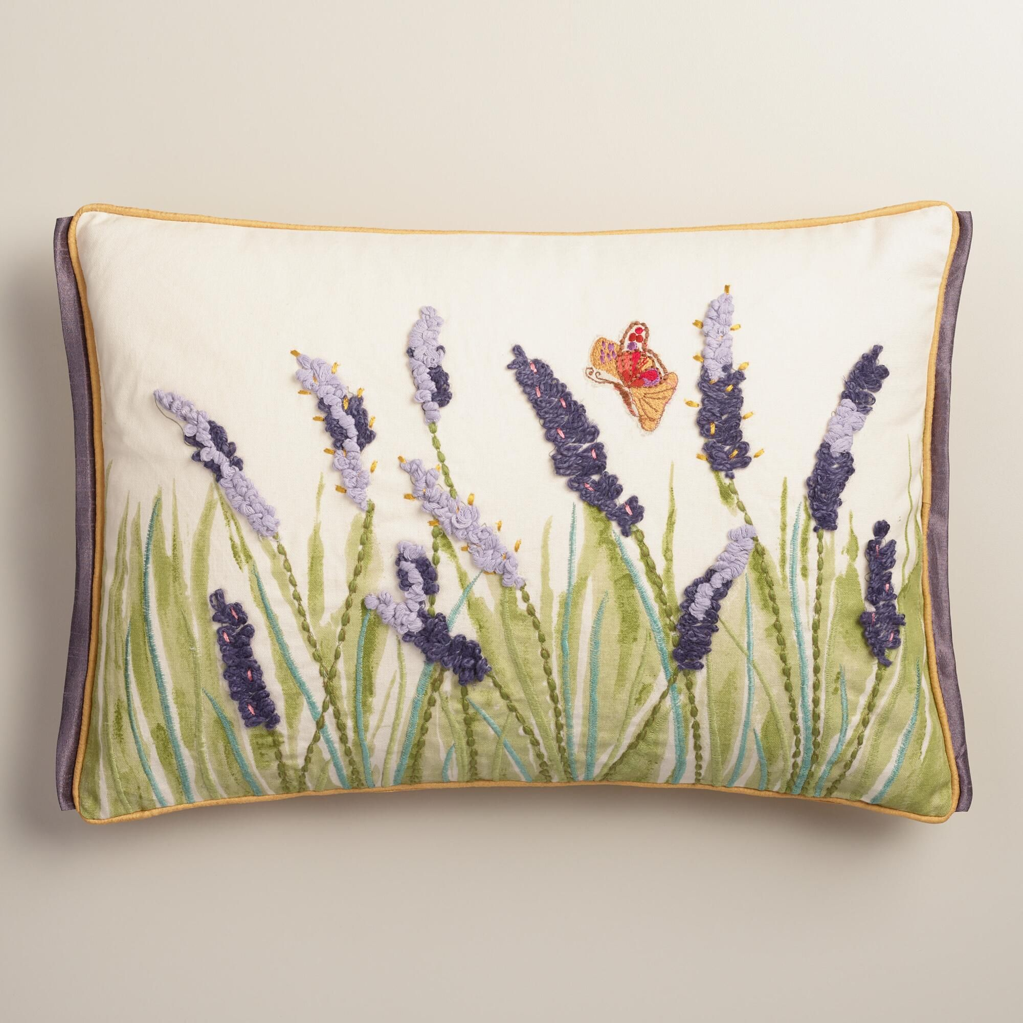 Featuring our enchanting floral design with intricate embroidery, crocheted yarn details, lavender flange and piping, this exclusive throw pillow is an artful accent with three-dimensional flair and a dupioni back.