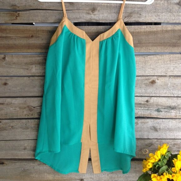Turquoise Tank Top This color blocked turquoise and tan summery tank is from Nordstrom. NWT, flowy and fun. Simple paired with a statement necklace and black skinnies, or work ready under a blazer. XS. Tops