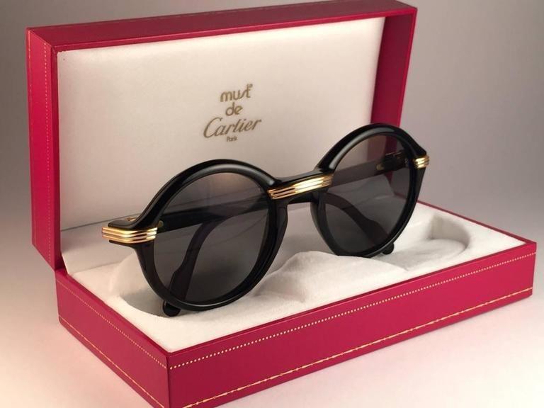 c980005a4dc6a Cartier Cabriolet Round Black   Gold 52MM 18K Gold Sunglasses France 1990 s