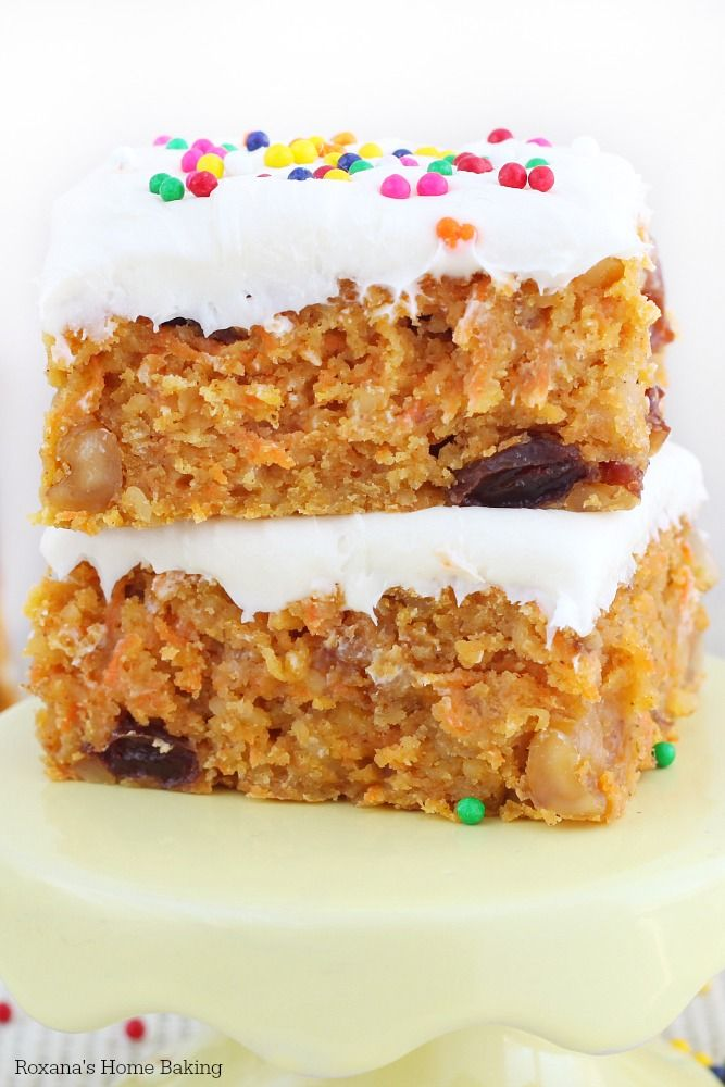 Speckled with freshly grated carrots, walnuts and raisins, these super moist carrot cake bars are the easier version of the traditional carrot cake