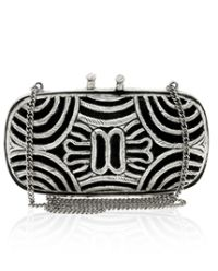 metal clutches | ASOS metal cutwork clutch jumps on cage bag trend | The Bag Lady