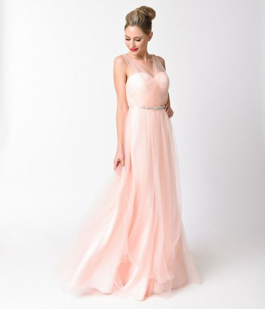 This is the perfect dress for a special occasion! Modest in fit, this full tulle gown has sheer straps with a sweetheart neckline and padding at the bust. The bodice is fitted while the skirt takes on a slight ballgown shape.