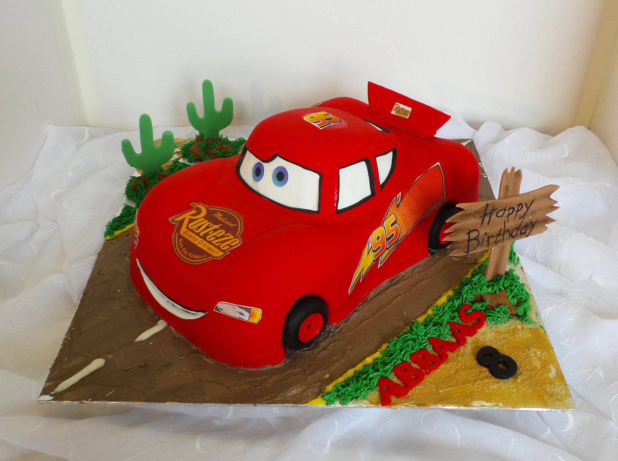 Lightning McQueen Cars shaped birthday cake Lightning mcqueen