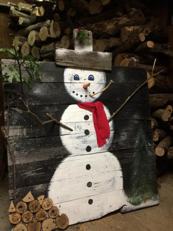 Discover the greatest upcycled products and post what inspires you. Painted snowman on a wooden pallet, with a real carrot for a nose and sticks for arms, old barn wood makes his hat and some red felt make his