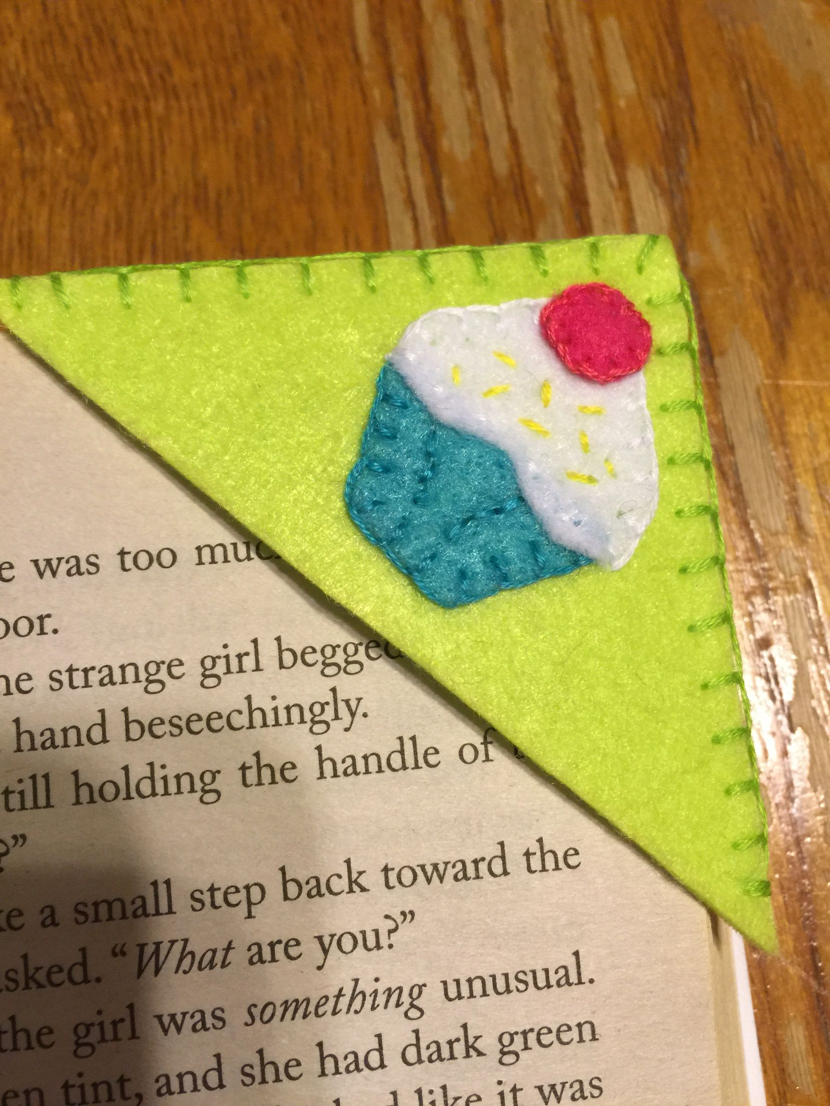 Felt corner bookmark!   Fits into any book.  Handmade. Can be found on etsy.com.