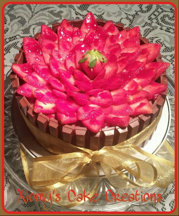Kit Kat Chocolate Cake Decorated With A Beautiful Strawberry Rose