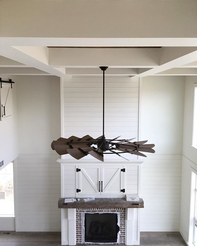 Shiplap and brick fireplace surround with a windmill fan for Modern farmhouse fireplace