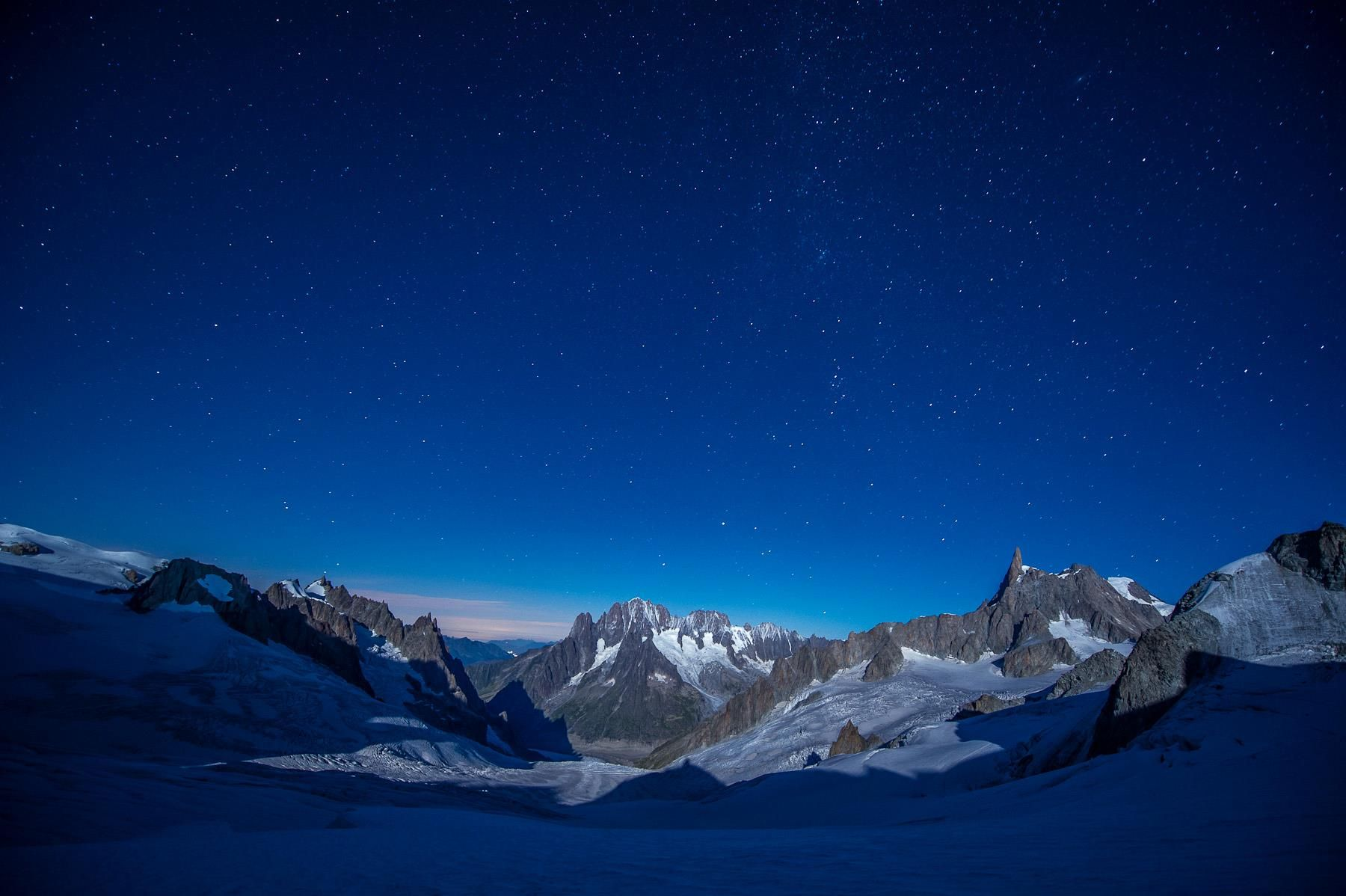 If you happen to be on the Italian side of Mont Blanc Massif, look back and enjoy the spectacular interplay of moon light and shadows. On the photograph, the eastern summits of Mont Blanc Massif with iconic Deant du Geant on the right. Photo taken during last assignment in Chamonix.