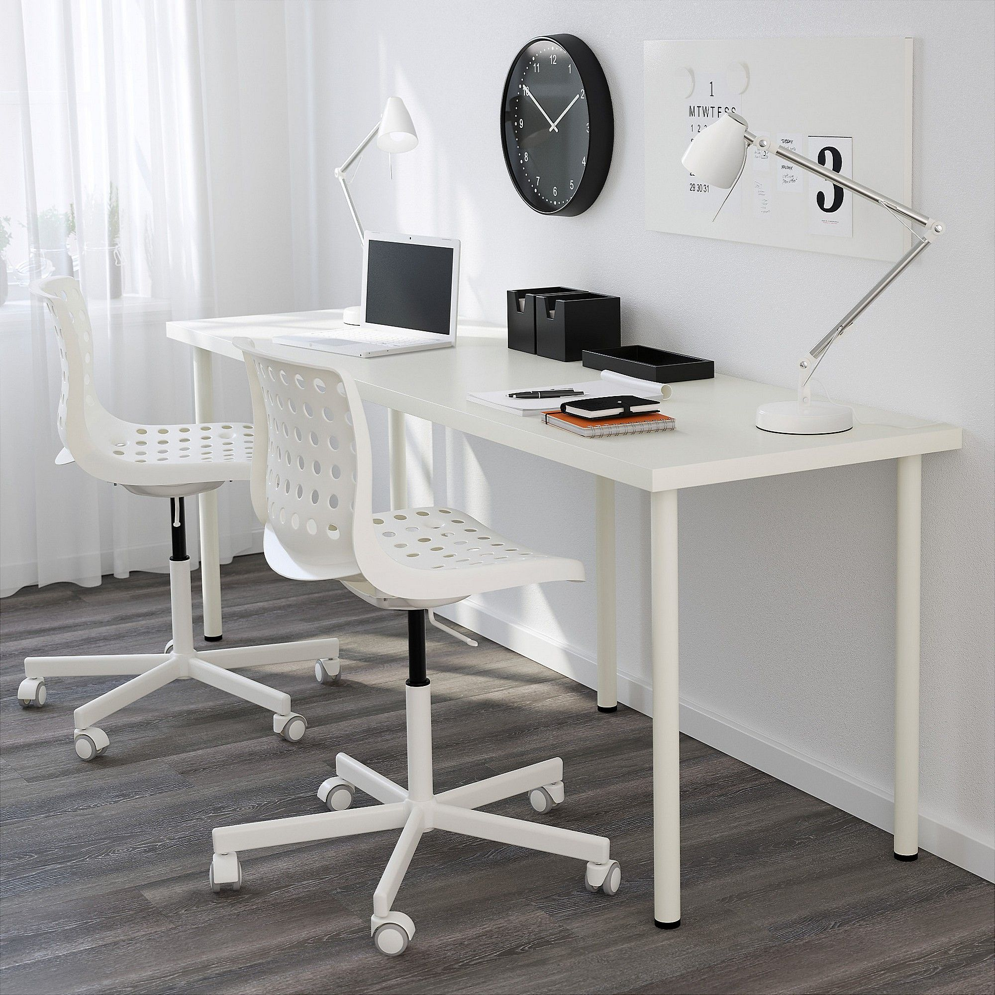 clean white ikea linnmon adils desk setup with laptop on it