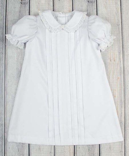Pretty pleated details and sweet puff sleeves enhance the girly charm of this oh-so-sweet dress.