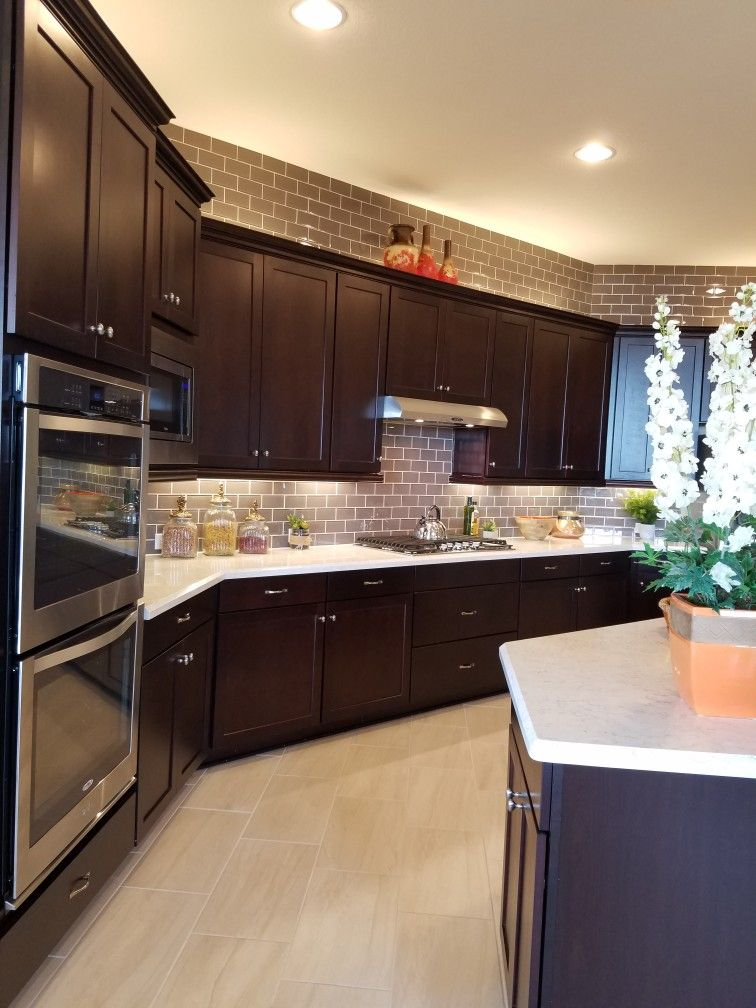 glass tile to the ceiling above the cabinets beazerhomes daltile kitchen cabnets kitchen on kitchen cabinets to the ceiling id=28529
