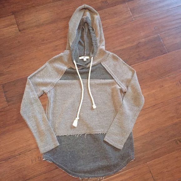 NWOT Colorblock Patched Hoodie Such a cute hoodie! round hem for a flattering look.  Pair with leggings for a cool, casual look.  Bought from The Rage.  Supposed to look frayed, raw hem. Tops Sweatshirts & Hoodies