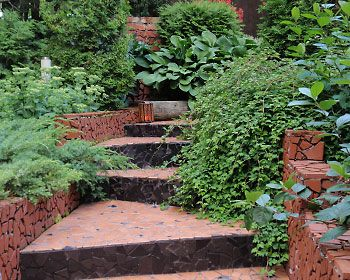 Raised bed garden on entryway stairs