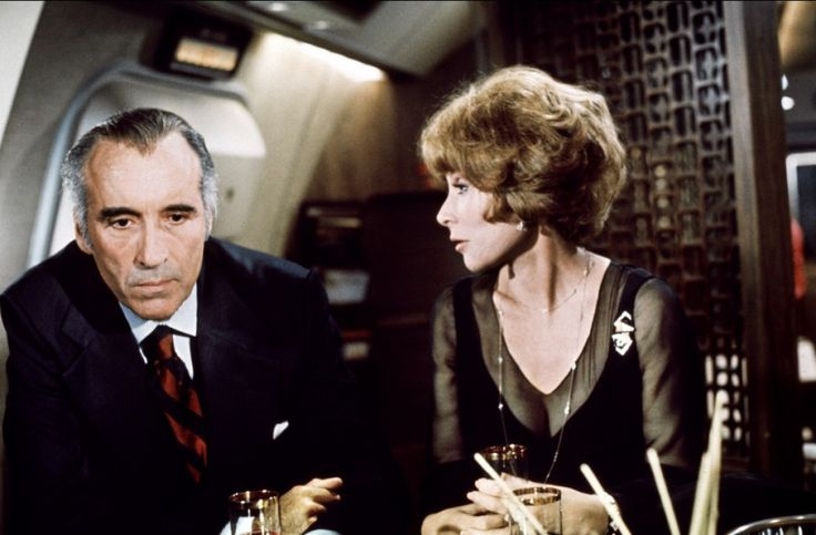 With Christopher Lee in AIRPORT '77 (1977). | Lee Grant