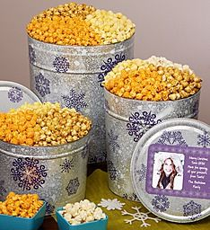 send gourmet christmas popcorn gifts to your nice list from a variety of festive christmas popcorn tins unique gift baskets fun christmas popcorn balls