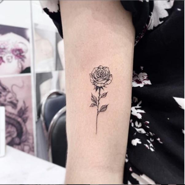 Single rose tattoo