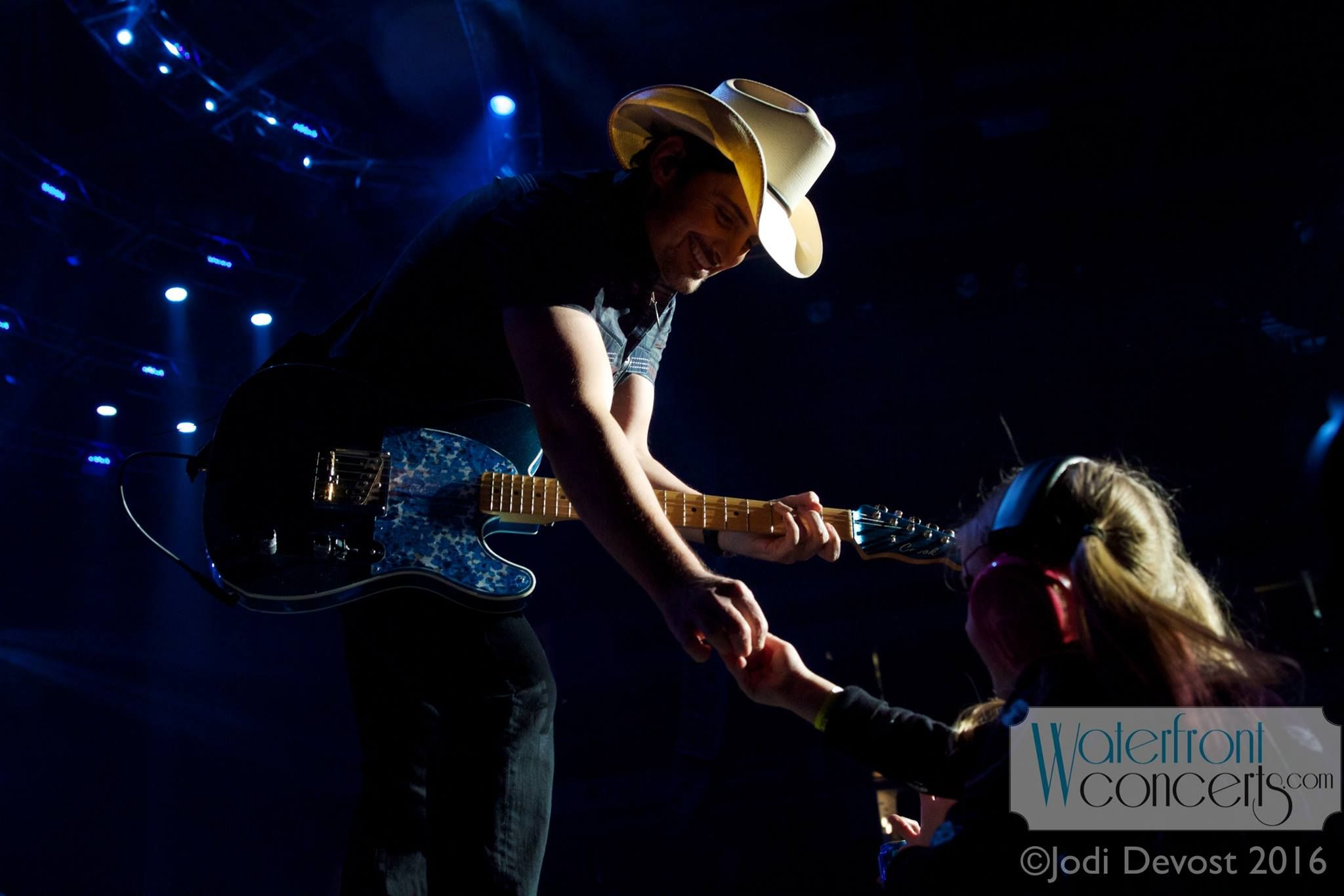 Brad paisley performing at cross insurance center in