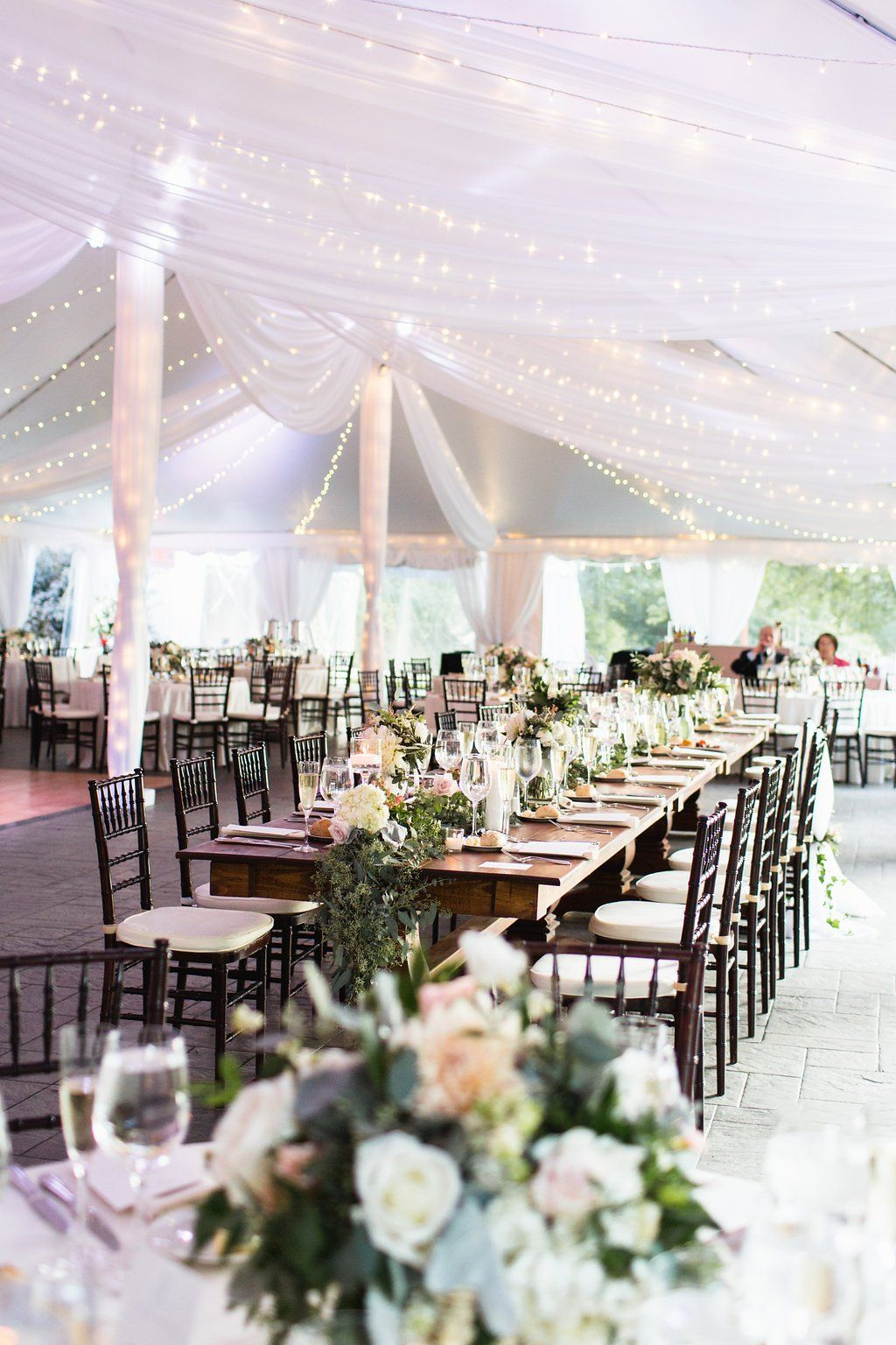 Sparkling Tent Wedding Decor With Fairy Lights And Trailing Greens On The Newport Bride Outdoor Wedding Reception Tent Outdoor Fall Wedding Wedding Tent Layout
