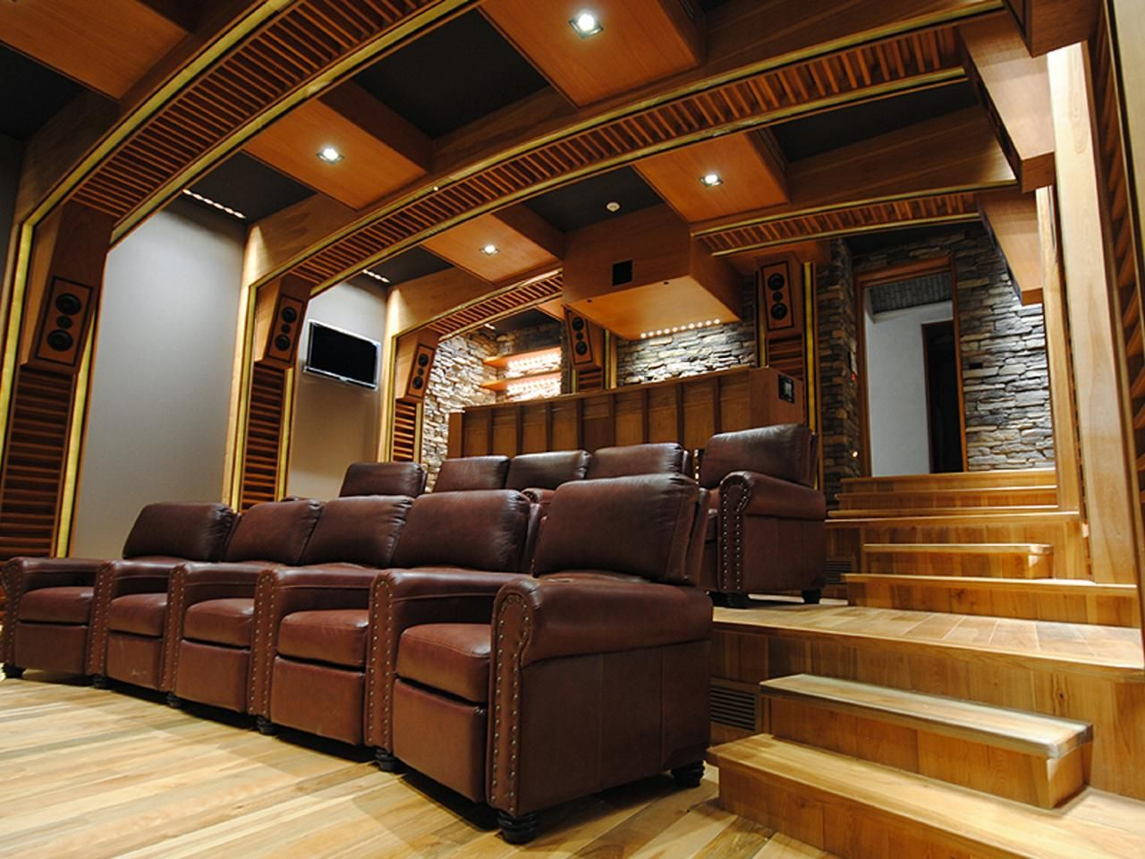 Media room with stadium seating home theater with - Home theater stadium seating design ...