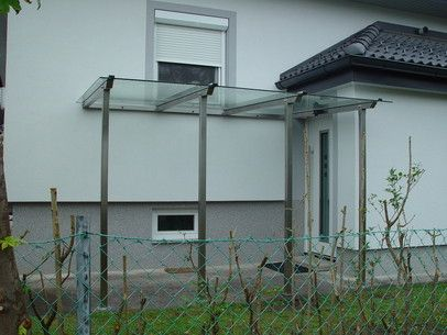 vordach aus edelstahl und glas edelstahl vordach glas. Black Bedroom Furniture Sets. Home Design Ideas