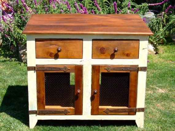 """Our French Cottage Cabinet is made from 100+ year old reclaimed barn wood. This cabinet is 32"""" tall. 20"""" deep and 44"""" wide. The cabinet doors are made with antiqued chicken wire and are framed in barn wood. The iron hardware is hand made in in Europe. It is painted with a cream milk paint over off-white milk paint and is lightly distressed to the natural exposed wood. The cabinet is completed with a hand waxed finish to a soft luster. This item is made by master craftsman, Chris McGean"""