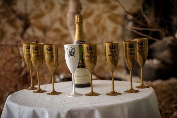 Fun wedding reception decor idea  with personalised champagne flutes