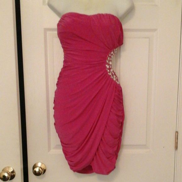 Beautiful Pink Evening/Prom Dress NWOT Short Strapless Above Knee Pink Dress W/side cutout and Rhinestone Trim around the cutout. Back Zipper. Frederick's of Hollywood Dresses